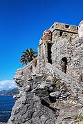 Dragonara Castle built in the twelfth century to defend the coastal village, Camogli, Genoa , Italy.