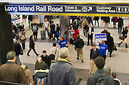 Manhattan, New York, U.S. 4th November 2013. TOM SUOZZI, Democratic candidate for Nassau County Executive, (R, in front on sign) meets potential voters descending the escalators during his campaign stop at Penn Station, near end of 36 straight hours of barnstorming across Nassau County, leading up to the November 5 general election. Former Nassau County Executive Suozzi and incumbent Republican Mangano are once again facing each other as challengers.