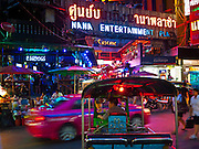 "13 JULY 2011 - BANGKOK, THAILAND:  Traffic in front of the entrance to the Nana Entertainment Plaza, a ""red light"" district in Bangkok. Prostitution in Thailand is illegal, although in practice it is tolerated and partly regulated. Prostitution is practiced openly throughout the country. The number of prostitutes is difficult to determine, estimates vary widely. Since the Vietnam War, Thailand has gained international notoriety among travelers from many countries as a sex tourism destination. One estimate published in 2003 placed the trade at US$ 4.3 billion per year or about three percent of the Thai economy. It has been suggested that at least 10% of tourist dollars may be spent on the sex trade. According to a 2001 report by the World Health Organisation: ""There are between 150,000 and 200,000 sex workers (in Thailand).""  PHOTO BY JACK KURTZ"