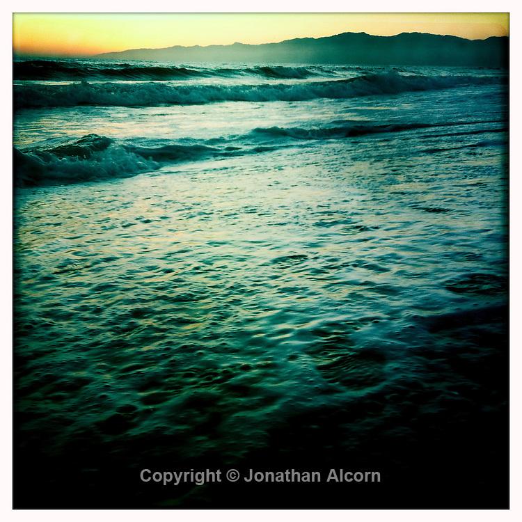 High tide at sunset in Venice Beach, California