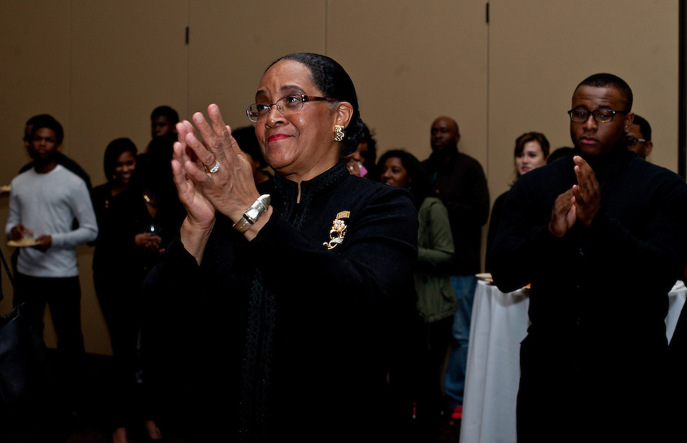 Ohio University First Lady Deborah McDavis applauds during her husband Ohio University President Roderick J. McDavis's speech at the All Black Affair at Baker University Center Ballroom at Ohio University on Friday, January 29, 2016. © Ohio University / Photo by Sonja Y. Foster