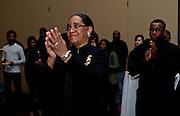 Ohio University First Lady Deborah McDavis applauds during her husband Ohio University President Roderick J. McDavis's speech at the All Black Affair at Baker University Center Ballroom at Ohio University on Friday, January 29, 2016. © Ohio University / Photo by Sonja Y. Foster