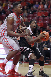 10 November 2014:  John Jones looks for a way to stop a shot by Gabe Williams during an exhibition men's basketball game between Lewis University Flyers and the Illinois State Redbirds at Redbird Arena, Normal IL