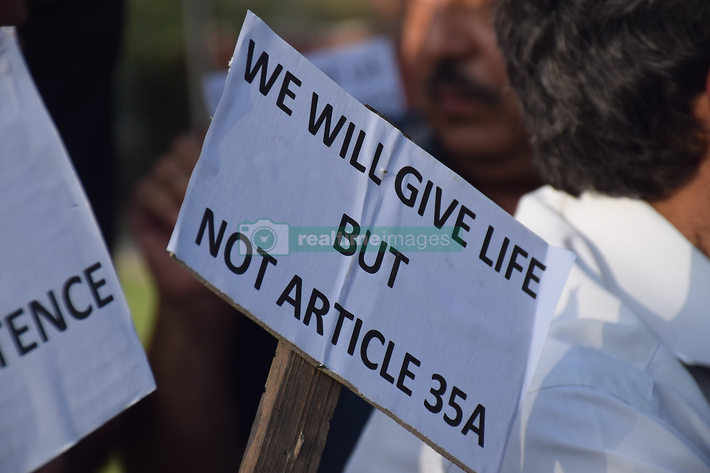 August 17, 2017 - Srinagar, India - Civil society of Kashmir hold a sit protest at press colony Srinagar against the proposed removal of Article 35A. On having a talk with one of their member, he said that India will break all the promises he made in written if the removal take place. (Credit Image: © Abbas Idrees/Pacific Press via ZUMA Wire)