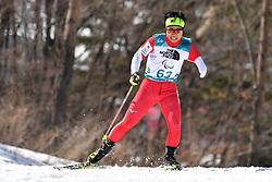 HOSHIZAWA Masaru JPN LW8 competing in the ParaBiathlon, Para Biathlon at  the PyeongChang2018 Winter Paralympic Games, South Korea.