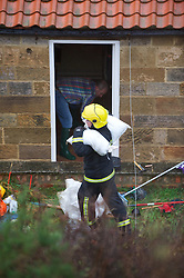 © Licensed to London News Pictures. 25/11/2012..North East England..A fire crew attend a call to a flooded house on the outskirts of Saltburn this morning as heavy overnight rain caused traffic disruption and flooding in parts of Cleveland and North Yorkshire this morning...Photo credit : Ian Forsyth/LNP