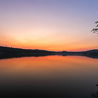Way up north in New Hampshire is the town of Pittburg and North Country. I traveled along moose alley up to the Canadian border looking for fall foliage and moose to photograph. On the way back I was drawn to Back Lake as the sky started to burn up and transformed into a beautiful sunset.      <br />