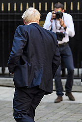 © Licensed to London News Pictures. 23/07/2019. London, UK. Public relations Photographer ANDREW PARSONS, newly appointed special advisor to British Prime Minister Boris Johnson is seen photographing Boris Johnson (front) as he arrives at Conservative Party Headquarters (CCHQ) in London . Photo credit: Ben Cawthra/LNP