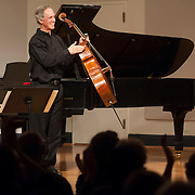 June 12, 2012 - New York, NY : Cellist Eric Bartlett applauds the composer Peter Susser (not pictured) who was in attendance for Bartlett's performance of Mr. Susser's 'Five Ballads' (1998) during the Institute & Festival for Contemporary Performance 2012 at the Mannes Concert Hall in Manhattan on Tuesday night. CREDIT: Karsten Moran for The New York Times