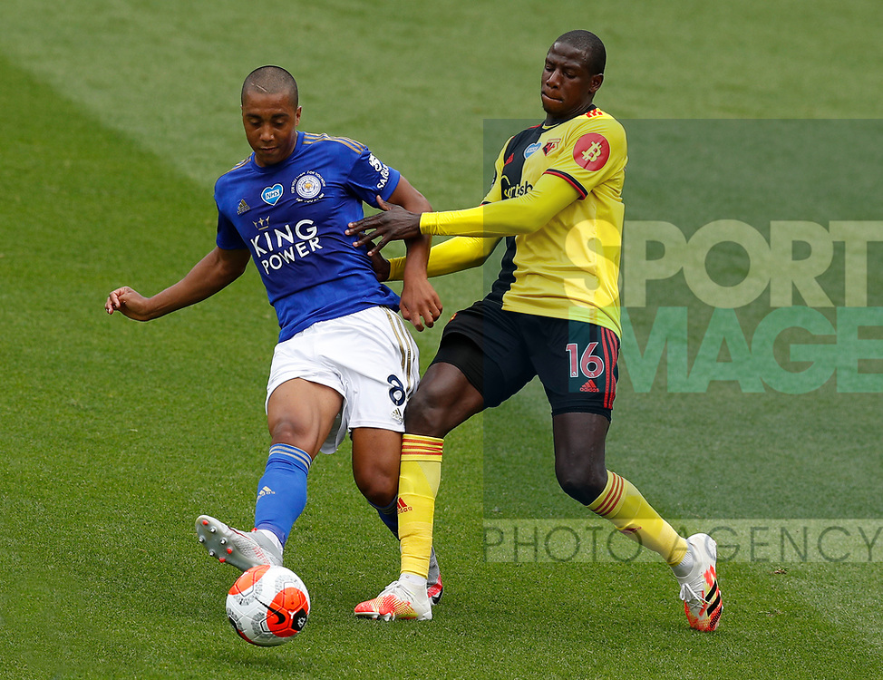 Youri Tielemans of Leicester City tackled by Abdoulaye Doucoure of Watford during the Premier League match at Vicarage Road, Watford. Picture date: 20th June 2020. Picture credit should read: Darren Staples/Sportimage