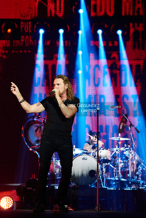 Fher Olvera, Alex Gonzalez, Sergio Vallin and Juan Calleros of Mexican band Mana performs on Stage during 'Cama Incendiada Tour' at Barclaycard Center (Palacio de los Deportes) on September 4, 2015 in Madrid