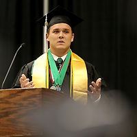 Mooreville Salutatorian Braeden Martin addresses his class during the Mooreville High School graduation ceremony Saturday.