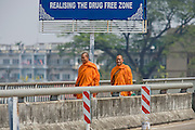 "26 FEBRUARY 2008 -- MAE SOT, TAK, THAILAND: Buddhist monks cross the Thai-Myanmar Friendship Bridge into Myawaddy, Myanmar from Mae Sot, Thailand. There are millions of Burmese migrant workers and refugees living in Thailand. Many live in refugee camps along the Thai-Burma (Myanmar) border, but most live in Thailand as illegal immigrants. They don't have papers and can not live, work or travel in Thailand but they do so ""under the radar"" by either avoiding Thai officials or paying bribes to stay in the country. Most have fled political persecution in Burma but many are simply in search of a better life and greater economic opportunity.  Photo by Jack Kurtz"
