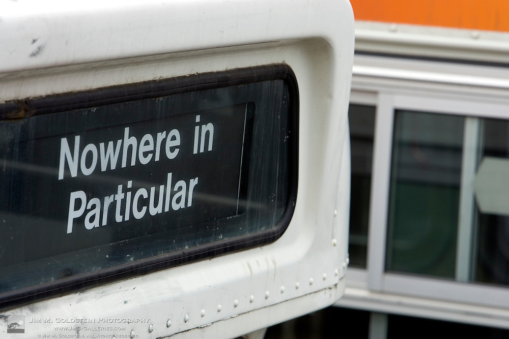 An urban landscape at the San Francisco bus yard of a bus destination sign reading No Where In Particular