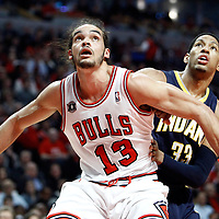 CHICAGO, IL - APR 18: Joakim Noah #13 of the Chicago Bulls fights for position with Danny Granger #33 of the Indiana Pacers during game 2 of the Eastern Conference First Round at the United Center on April 18, 2011 in Chicago, IL. NOTE TO USER: User expressly acknowledges and agrees that, by downloading and or using this photograph, User is consenting to the terms and conditions of the Getty Images License Agreement. Mandatory Credit: 2011 NBAE (Photo by Chris Elise/NBAE via Getty Images)