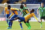 Bayo Akinfenwa of AFC Wimbledon battles  during the Sky Bet League 2 match between Mansfield Town and AFC Wimbledon at the One Call Stadium, Mansfield, England on 5 September 2015. Photo by Stuart Butcher.