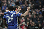 Chelsea's Cesc Fabregas celebrates after Chelsea's Eden Hazard scores the forth goal of the game to make the score 3-1 during the Premier League match between Manchester City and Chelsea at the Etihad Stadium, Manchester, England on 3 December 2016. Photo by Simon Brady.