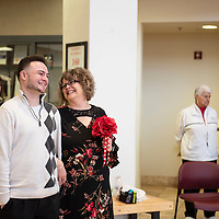 PJ Montoya walks his mom Sara Keeler down the aisle in the rotunda of the McKinley County Courthouse on Valentine's Day, Thursday, Feb. 14. Keeler is from Gallup and works on the 3rd floor of the courthouse.