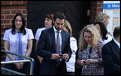 Kensington Palace staff and Nurses wait outside St.Mary's hospital for the announcement of  the birth of the Duke and Duchess of Cambridge's baby outside the Lindo Wing of St.Mary's hospital in London after the Duchess of Cambridge arrived after going into labour in the early hours of the morning, Monday, 22nd July 2013<br /> Picture by Andrew Parsons / i-Images