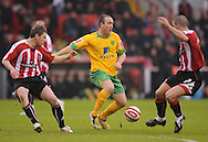 Sheffield - Saturday January 9th, 2009: Gary Naysmith & Nick Montgomery of Sheffield United and Lee Croft of Norwich City during the Coca Cola Championship match at Bramall Lane, Sheffield. (Pic by Alex Broadway/Focus Images)