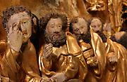Detail of the Death of the Virgin, with mourning apostles surrounding her body, from the Altarpiece of the Virgin, 1430-40, in the Eglise de Saint-Roch, Ternant, Nievre, Burgundy, France. The altarpiece was commissioned by Philippe de Ternant and his wife Isabeau de Roye, and depicts 7 scenes of the Life of the Virgin, both painted and sculpted, including the Annunciation, Dormition and Glorification. It was made by Brabant and Flemish workshops in painted and gilded carved wood. The altarpiece has been restored many times and is listed as a historic monument. Picture by Manuel Cohen