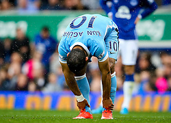 Sergio Aguero of Manchester City holds on to his ankles during a break in play - Mandatory byline: Matt McNulty/JMP - 07966386802 - 23/08/2015 - FOOTBALL - Goodison Park -Everton,England - Everton v Manchester City - Barclays Premier League