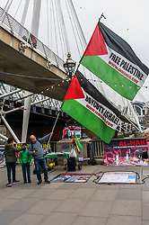 April 13, 2018 - London, UK. 13th September 2018. A vigil on the South Bank of the River Thames on Palestinian Prisoners Day highlights the plight of the roughly 6,500 Palestinians currently in Israeli jails, around 350 of them children. The protesters included several Palestinians and were joined by an anti-zionist ultra-orthodox Jew. Their display included an actual size drawing of an Israeli underground prison cell in which children are held in isolation. The protesters handed out leaflets and talked with those walking by, and speeches gave facts about the prisoners.  In two months this year alone 1319 were imprisoned, including 274 children, 23 women and four journalists. Over 500 of these prisoners are currently held indefinitely without charge or trial under administrative detention orders. Physical torture during interrogation is standard practice, even for children, and many are sexually abused;  since 1967, 72 prisoners have been tortured to death. As a part of the Israeli 'apartheid' system, Palestinians are not tried by the Israeli civil courts but by military tribunals with a 99.74% conviction rate. Since 1967, roughly 1 in 5 of the entire Palestinian population have been held in prison at some time. The protest, organised by Inminds human rights group, called for a boycott of Israeli goods and of companies including HP who are complicit by supplying the IT infrastructure which runs the Israeli prisons and torture dens. Peter Marshall IMAGESLIVE (Credit Image: © Peter Marshall/IMAGESLIVE via ZUMA Wire)