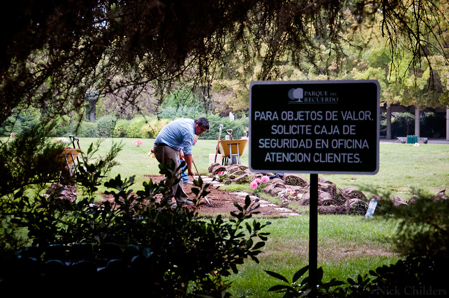 Santiago, Chile 2010<br /> <br /> Gravediggers tend to fresh graves at the Parque de Recuerdo cemetery two weeks after the 7.7 earthquake that struck just outside the capital of Santiago.