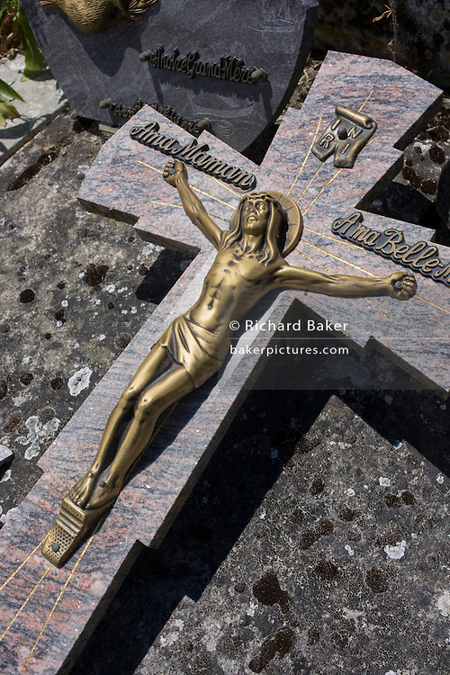Detail of a crucifix in the cemetery of the church of St Radegonde in Talmont-sur-Gironde, Charente-Maritime, France. Built in 1094, the church was a resting place for the Pilgrimage of Saint James of Compostela on the via Turonensis, because the pilgrims crossed the river Gironde at this spot.