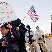 012013       Cable Hoover<br /> <br /> Seven-year-old Call Lemon carries a sign that reads &quot;Keep the Dream Alive&quot; as he stand for the National Anthem during the Martin Luther King day rally at the McKinley County Courthouse plaza in Gallup Sunday.