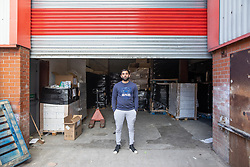 "© Licensed to London News Pictures. 07/05/2020. Salford, UK. Manager at Puro Medico SALAIMAAN MAJID (28) stands in front of the newly repaired shutters outside the warehouse from where the PPE was stacked up when it was stolen . £166,000 (one hundred and sixty six thousand pounds) worth of protective masks , which were destined for the NHS and care homes , have been stolen from a warehouse overnight (6th-7th May 2020) in what Greater Manchester Police are describing as a "" targeted burglary "" . Thieves cut the shutters at the loading bay of Puro Medico - which specialises in importing PPE such as masks from China and hand sanitiser from Poland - and stole several pallets of stock , which was loaded on to vans over a two hour period . Photo credit: Joel Goodman/LNP"