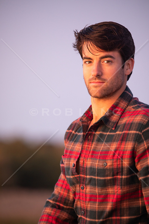 portrait of a handsome man at sunset
