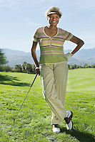 Senior woman on golf course (portrait)