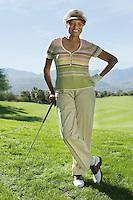 Senior woman on golf course (portrait)