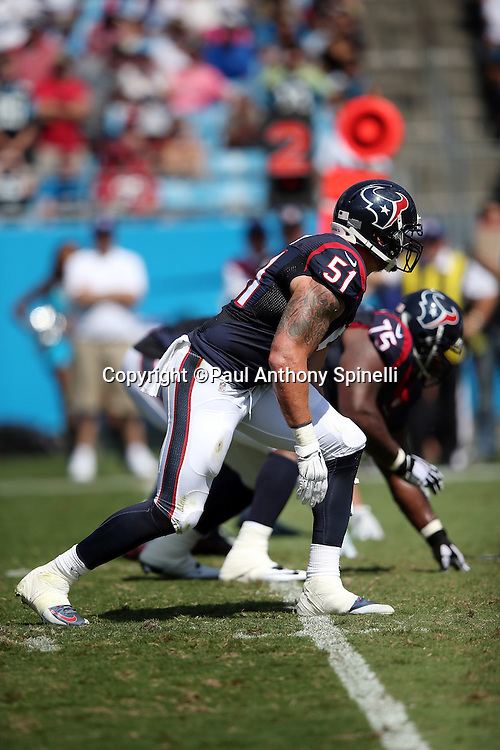 Houston Texans outside linebacker John Simon (51) gets set during the 2015 NFL week 2 regular season football game against the Carolina Panthers on Sunday, Sept. 20, 2015 in Charlotte, N.C. The Panthers won the game 24-17. (©Paul Anthony Spinelli)