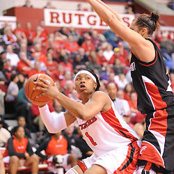 Feb 24, 2009; Piscataway, NJ, USA; Rutgers guard Khadijah Rushdan (1) controls the ball away from Cincinnati guard Kahla Roudebush (20) during the second half of Rutgers' 71-52 victory over Cincinnati at the Louis Brown Athletic Center.