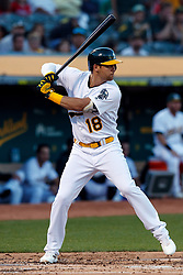 OAKLAND, CA - SEPTEMBER 21:  Chad Pinder #18 of the Oakland Athletics at bat against the Texas Rangers during the first inning at the RingCentral Coliseum on September 21, 2019 in Oakland, California. The Oakland Athletics defeated the Texas Rangers 12-3. (Photo by Jason O. Watson/Getty Images) *** Local Caption *** Chad Pinder