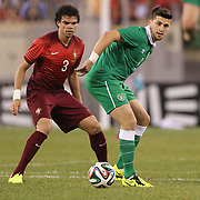 Pepe, (left), Portugal, and Shane Long, Ireland, in action during the Portugal V Ireland International Friendly match in preparation for the 2014 FIFA World Cup in Brazil. MetLife Stadium, Rutherford, New Jersey, USA. 10th June 2014. Photo Tim Clayton
