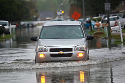 22 March 2014. Marrero, Louisiana. <br /> Storms sweep through the region flooding low lying streets.<br /> Photo; Charlie Varley