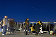 Highland, New York - People line up to look at the full moon through telescopes on the Walkway over the Hudson on Oct. 18, 2013. The Mid-Hudson Astronomical Association had telescopes set up to view the moon. The Big Dipper is above the telescope at right.