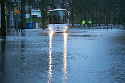 © Licensed to London News Pictures. 13/2/2014. Worcester, UK. The River Severn flowing through Worcester reaches an all time high. Pictured, the main Worcester bridge is closed, so a shuttle bus transports commuters into the City Centre. Photo credit : Dave Warren/LNP