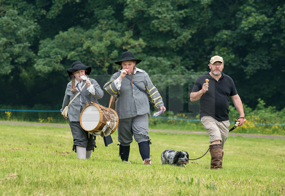 © Licensed to London News Pictures. 27/05/2018. Bristol, UK. Members of the Sealed Knot English civil war reenactment society leave the 20th century behind to perform for the 375th anniversary of the Siege of Bristol at Ashton Court estate over the end of May Bank Holiday Weekend, with an explosive display of Cannon, Musket, Pike and Cavalry as the Sealed Knot re-enacts the Siege on the Battlefield. Photo credit: Simon Chapman/LNP