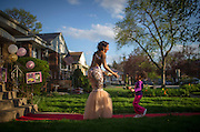 Kietta Saunders greets her cousin Faith Dilworth on the red carpet in Kietta's front yard during her prom send-off party Friday, May 9, 2014 in Elmwood Park. (Brian Cassella/Chicago Tribune) B583716571Z.1 <br /> ....OUTSIDE TRIBUNE CO.- NO MAGS,  NO SALES, NO INTERNET, NO TV, CHICAGO OUT, NO DIGITAL MANIPULATION...
