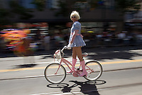 SAN FRANCISCO, CA - JUNE 24 : A man rides on a bike as he takes part in the 37th annual LBGT Pride Parade on June 24, 2007 in San Francisco, California. Hundreds of thousands of people lined the streets of San Francisco to watch and take part in the parade.  (Photograph by David Paul Morris)