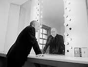 View of man's reflection in mirror.