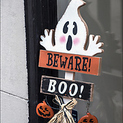 Halloween decorations on side of brownstone in Greenwich Village, NYC.