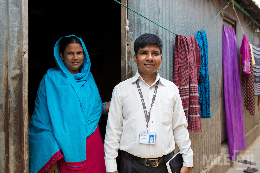 Rahidul Islam (right) with Kohinur, who is a garment worker living and working in Dhaka, Bangladesh.<br /> <br /> Rahidul works for the BRAC microfinance, financial diaries project. This programme works to improve the financial literacy of garment workers.