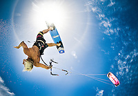Sun flare and kiteboarder in the Caribbean