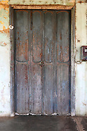 Weathered door in San Antonio de Rio Blanco, Mayabeque, Cuba.