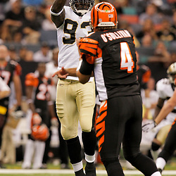 2009 August 14: New Orleans Saints defensive end Bobby McCray (93) pressures Cincinnati Bengals quarterback J.T. O'Sullivan (4) during a preseason opener between the Cincinnati Bengals and the New Orleans Saints at the Louisiana Superdome in New Orleans, Louisiana.